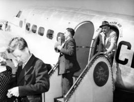 [Men disembarking from a Trans Canada Air Lines plane during visit of King George VI and Queen El...