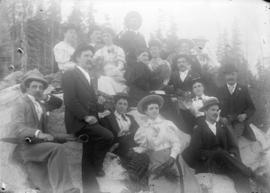 [Men and women assembled for picnic at Barnet Beach]