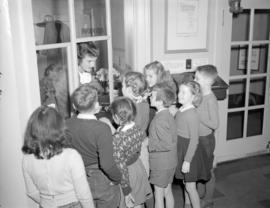 [Group of children gathered at the information booth of the Vancouver Art Gallery]