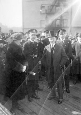 Harry Gale [with navel/military officers and onlookers]