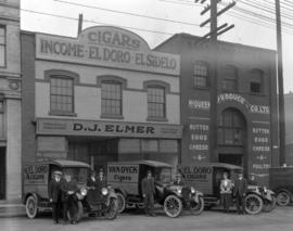 [D.J. Elmer Wholesale Tobacconist] trucks and staff [in front of their building at 27 West Pender...