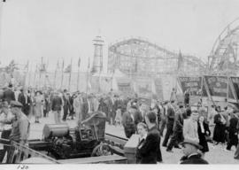 Crowd in midway carnival, in front of sideshows