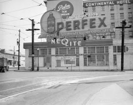 [Exterior view of the Neolite Co. building with a Perfex bleach neon sign on the roof]