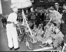 Clown with crowd at 1953 P.N.E. Opening Day Parade