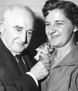 [Major J.S. Matthews pins a corsage onto Mrs. Eric C. Martin at a Kitsilano Ratepayers Associatio...