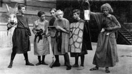 [Ted Taylor and other performers in costume for a school play]