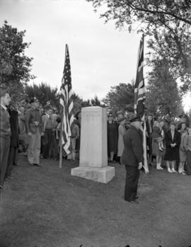 [Crowds gathered at the cairn marking the Canadian border for the Boundary Treaty Centennial cele...