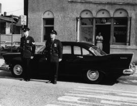 [Two Vancouver Police Officers standing front of car at 213 East Cordova]