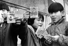 Young Japanese-Canadians [showing off hockey cards]