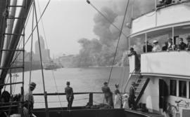 "[View from a ship at the Union Steamship dock of the fire at Pier ""D""]"