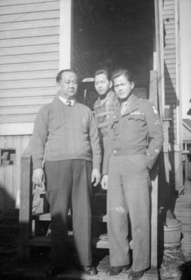 Donald Wong with two unidentified men