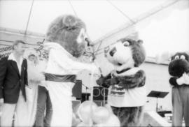Tillicum and bear mascot on stage