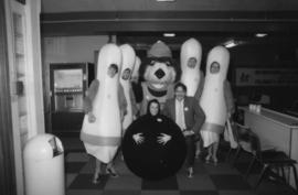 Tillicum and group dressed as bowling pins and a bowling ball