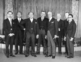 [Group portrait of Mayor L.D. Taylor  with other men in formal attire, possibly during a Japanese...