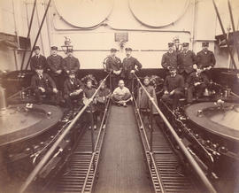 "[Engineers and labourers in the engine room of R.M.S. ""Empress of Japan""]"