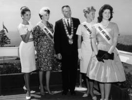 Miss P.N.E. 1961 contestants posing with Burnaby Mayor A. Emmott