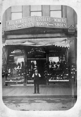 [Charles Gross in front of his shoe store at 313 Carrall Street]