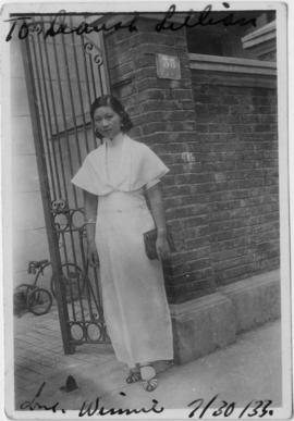 Winnifred Eng on front porch of house