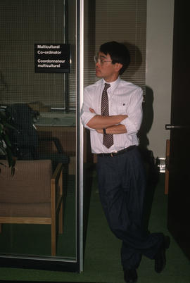Paul Yee at the door to his office at the Archives of Ontario