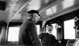 "[Men in the wheelhouse of the S.S. ""Camosun""]"