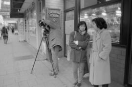 Crew taping outside a shop in Chinatown for the Saltwater City video