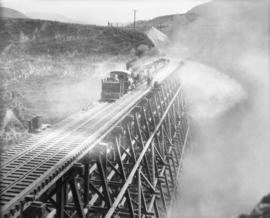 Filling the trestle at Mile 2.2 K.V.R. : The top of the trestle showing dust