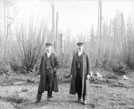 [Henry and Sinclair Barrow, standing in a clearing near Lynn Creek]