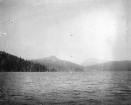 [View across the water from a logging camp]