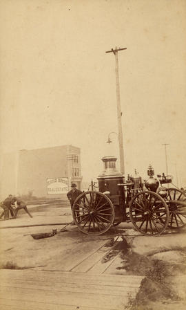 [Fire engine being filled with water on Granville Street and Dunsmuir Street]