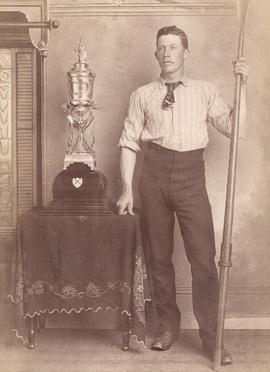 [William Watts with the trophy for winning the Amateur Championship Single Scull Rowing competiti...