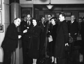[Miss Jessica Tandy, actress, accepting a yellow rose from Major Matthews at City Hall]