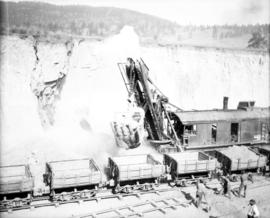 Filling the trestle at Mile 2.2 K.V.R. : The shovel digging, a corner of the cut falling