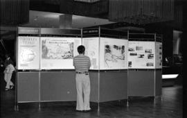Man viewing the Vancouver City Archives' display, Portholes and Pilings