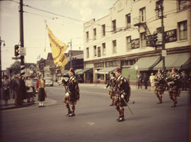 Shriners pipe band with standard bearer