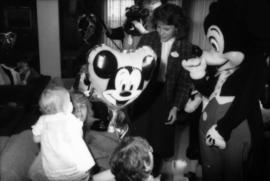 Mickey Mouse interacting with children