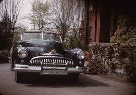Black Buick Roadmaster parked beside house at 1402 McRae Avenue