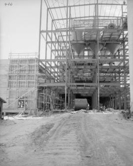 West end of sugar warehouse showing completed wall and forms for first lift on 1 & 5 column l...