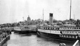 Coastal passenger vessels at dock-side with Parliament Buildings in background