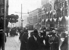 [Wartime parade of cars on Granville Street at Georgia Street]
