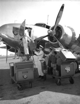 Canadian Pacific Airlines [luggage being loaded onto a plane]