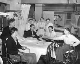[Veterans and nurses enjoy a diamond jubilee cake on a ward at Shaughnessy Hospital]
