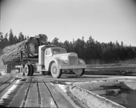 [Logging truck on the H.R. MacMillan Co. wharf]