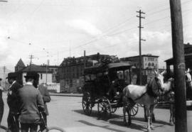 [The Royal Mail stagecoach on Granville Street near Pender Street]