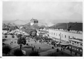 PNE 1940 : [view of Grandstand and Happyland amusement rides on Vancouver Exhibition grounds]