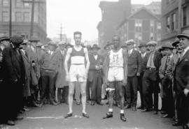 Two runners [with crowd, photo taken] for Mr. Williams, Hudson's Bay Co. Sporting Goods Dept.