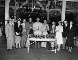 1955 Mink show : [P.N.E. directors and mink show officials posing with award winners]