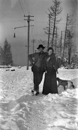 [Couple with dog on Waterloo Street and 4th Avenue]