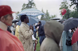 Man under umbrella at Canada Day celebration