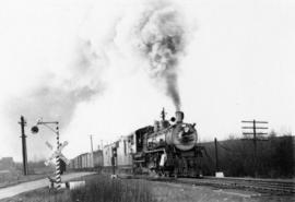 [G. N. R. Steam Eng. #1724 and train]