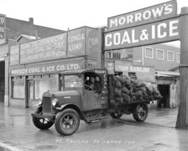 """15 Trucks to Serve You"" - [Morrow's Coal and Ice Company at 1025 Main Street]"
